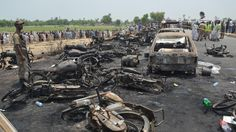 At least 150 people die, many of them as they gathered to collect fuel from the overturned lorry.