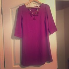 Pink dress by Buttons, sold at Francesca's This cute little magenta dress has a peek-a-boo back detail and can be dresses up or down Belt it or let it flow free! Size medium, from Francesca's, the brand is Buttons! Check out my page for the matching necklace as well! Dresses