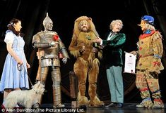 Not in Kansas now: Danielle Hope with her fellow Wizard of Oz cast members Edward Baker-Duly, David Ganly, Paul Keating and Michael Crawford Wizard Of Oz Cast, Wizard Of Oz Play, Wizard Of Oz Musical, New Wizard Of Oz, Musical Theatre, Led Costume, Costumes, Cast Member, Over The Rainbow