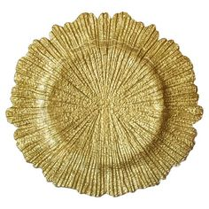 Add a pop of color to your tablescape with this delicately textured charger plate, perfect layered with crisp white linens for a pop of contrast.