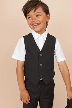 Vest in woven cotton fabric with buttons at front and mock pockets. Lined. Black Suit Vest, Boys Wedding Suits, Tweed Vest, Black Kids, Fashion Company, Slacks, Personal Style, Cotton Fabric, Clothing