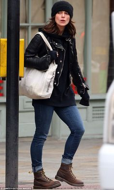 Keeping it casual: Keira donned a biker jacket for her stroll through West London yesterday