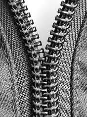 zipper began to be used in clothing...Elsa Schaparelli used contrasting colored zippers and also was the first designer to have zippers dyed to match the fabric, rendering them almost invisible.