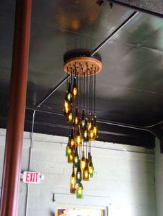 This was a custom 25 light wine bottle chandelier. There are 25 wine bottle lights hanging in a long spiral. The ceiling mount is 2 feet in circumference (Bottle Lights Design) Cool Lighting, Beer Bottle Diy, Lights, Beer Bottle Chandelier, Bottle Chandelier, Diy Lamp, Beer Bottle Crafts, Diy Bottle, Decor Lighting