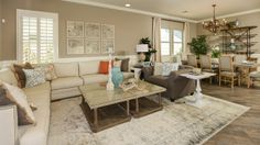 A spacious living room in the Bridges, a perfect community for both families and business professionals in Gilbert, Arizona.