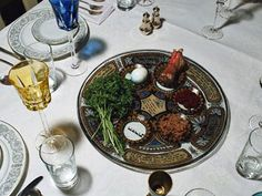 The Seder plate is a special plate used during the Passover feast. There are six foods showcased on the Seder plate, each with a special meaning to the Jewish faith: bitter herbs to represent the enslavement in Egypt; a sweet brown mixture to signify the mortar they used to build storefronts for the Egyptians; a vegetable and salt water used for dipping to signify the pain of the enslavement; an animal bone (usually lamb) to symbolize the lamb sacrificed at the Temple of Jerusalem
