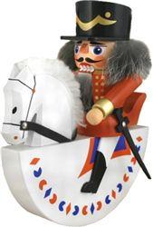 Nutcracker soldier on a white horse. Traditional Erzgebirge Seiffner design.