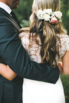 Love this wedding hair style with white roses. And look at the laced dress!