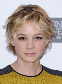 Carey Mulligan's slightly wavy bob looks so romantic paired with a thin headband. Steal her style:    1. Apply curl enhancing cream to damp hair and let it air dry to bring out your natural waves.   2. If your hair is naturally straight, wrap sections of your bob around a 1 1/2-inch curling iron to add waves.   3. Mist your hair with texturizing hairspray, and tousle it with your fingers. Slip on a thin headband to add a chic touch.