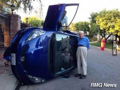 Elderly couple posing for photo after their car flipped (wife still trapped inside)