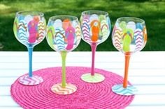 Enjoy these beautiful hand painted wine glasses, perfect for adding colorful pizazz to a wine party, a gathering or just enjoying a glass of wine at home. Tropical Wine Glasses, Fun Wine Glasses, Decorated Wine Glasses, Hand Painted Wine Glasses, Canvas And Cocktails, Decorating Flip Flops, Decorating Ideas, Decor Ideas, Paint And Drink