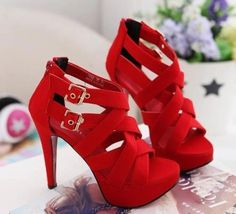 bright red heels with belt buckles
