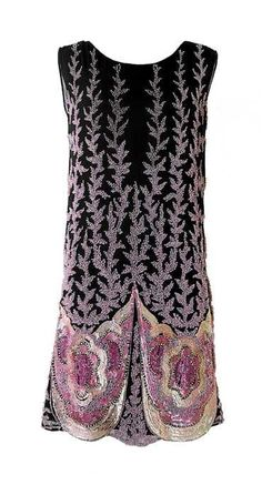 Charleston dress embroidered with beads and sequins in dfferent shades of pink on a black background, circa 1925.
