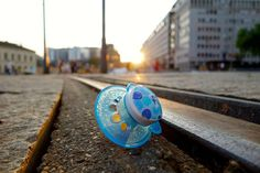 A pacifier lost and left in the track of a tram, Oslo
