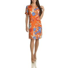 Strike a pose in this pretty Danillo Boutique floral print shift dress. This short-sleeved, knee-length dress is constructed of machine-washable polyester for comfort and durability. Lining: Fully Lin