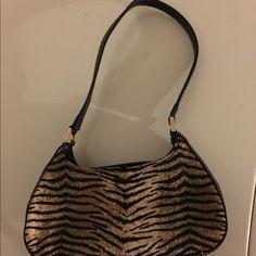 Like new, Leopard print small purse Liz Claiborne small, leopard print purse with zipper and strap. Liz Claiborne Bags Mini Bags