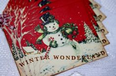"""A set of 8 handmade collage style Snowman Gift tags. .approximately 2.5 x 3"""" .vintage collage has been antiqued on edges for a vintage look .stamped Winter Wonderland sentiment in brown ink .set of 8"""