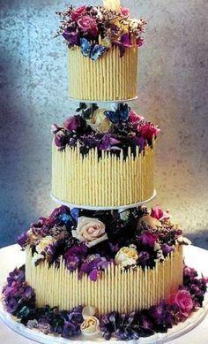 Cake surrounded with white chocolate fence and filled with fresh or edible flowers