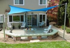 Benches built like this saves brick. Like the patio, but don't care for shade sails. Prefer a pergola. Deck Shade, Patio Sun Shades, Backyard Shade, Sun Sail Shade, Outdoor Shade, Backyard Patio, Sails For Shade, Shade For Patio, Patio Bench