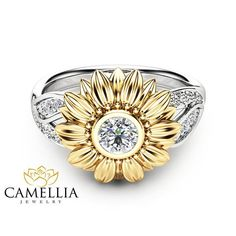 This is a natural diamond sunflower engagement ring from Camellia Jewelry. This unique design ring features a solid 14K two tone gold band with leaf accents and a luminous natural diamond in the center to complete the design. It is an inspired by nature ring that is unlike anything youll find in stores. Quality craftsmanship makes it an heirloom quality 14K white and yellow gold ring that can be passed down from one generation to the next. This is a limited edition Camellia Jewelry. Order…