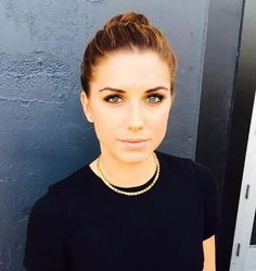 Alex Morgan. She is so pretty on and of the field!!!! I live this picture!