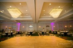 The center of your ballroom is highlighted with two beautiful crystal chandeliers.  #weddings