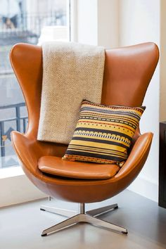 Egg chair - love the color and style! I think this would be a great accent with my mission furniture.