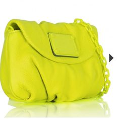 "Marc by Marc Jacobs Electro Yellow Crossbody This bold and beautiful Marc by Marc Jacobs Crossbody doubles as a clutch. It is crafted from textured premium leather and features a pleated base. Classic matt Marc Jacobs logo adorns the flap. Signature logoed fabric adorns the main compartment. Six interior card pockets. Magnetic snap closure. Leather and Matt chain strap. Measures: W 9.06"" x H 5.51"" x D 2.36"". Shoulder strap 45"". Marc by Marc Jacobs Bags Crossbody Bags"