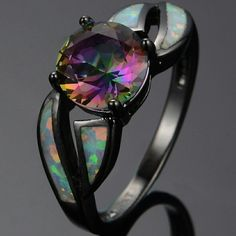 Onyx ring with fire Opal inlays, with a twist in the band! Maybe slightly more square (large gem) so incredibly gorgeous!