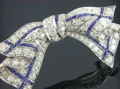 Art Deco Diamond & Sapphire Bow Pin Platinum Art Deco Bow Pin Set With Approximately 5.00 Carats Total Weight Of Old European Cut Diamonds And Custom Cut Sapphire Accents.