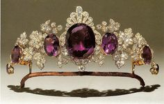 A large Siberian amethyst mounted as a jewel with diamond set honeysuckle motif 1810. The word amethyst derives from the Greek amethustos. literally meaning 'not drunken' referring to the belief that an amethyst placed in a glass of wine would allow one to drink without fear of intoxication. Also it stood for devotion in love