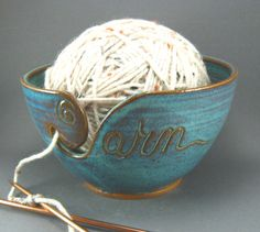 Beautiful yarn. I have seen lots of different ones out there but I love that this one actually says yarn. Also being someone who loves to knit all over the place I love yarn bowls. Available on Etsy through TheMudPlace's shop.