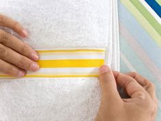 Applying Yellow and White Striped Ribbon on Towel