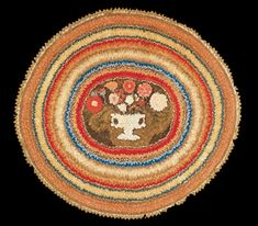 Antiques & Fine Art - Pollack, Frank & Barbara American Antiques & Art - A Circular Shirred Rug with a Stylized Urn of Flowers