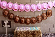 Cowgirl birthday party ideas - cowboy and cowgirl hats lined up