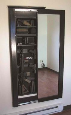 Hidden gun cabinet behind a mirror. We won't have that many, but for the ones we do. This is an idea! Hate the look of a gun cabinet Hidden Gun Cabinets, Hidden Cabinet, Bar Cabinets, Medicine Cabinets, Mirror Cabinets, Cabinet Doors, Tactical Wall, Hidden Gun Storage, Secret Storage