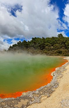 Walk along the shore of a geothermal pool in Rotorua, New Zealand as part of an 8-day trip across the country that includes airfare #GrouponGetaways
