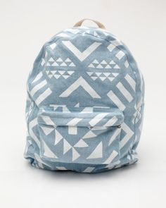 Need Supply Co. Dusen Pack in Nordic  Classic cotton canvas style back pack with all over screen-printed abstract triangle design from DUSEN DUSEN. Features outer front zip pocket, top zip closure, and adjustable cotton web strap pulls.