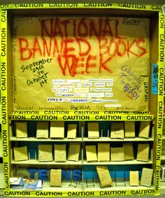 Banned Books Week library display. I love the caution tape idea. I was going to try and incorporate it into my display this year.