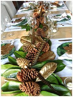 Thanksgiving table ... lovely centerpiece with magnolia leaves, pine cones and feathers