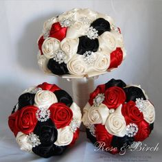 Set of bridal/wedding bouquets in red, black and ivory with gorgeous bling brooches, buttons and pearls. www.roseandbirch.com Handmade alternative wedding bridal bouquet fabric ribbon roses brooches brooch
