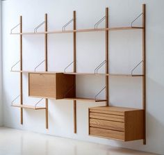 Beautiful reproductions of Cadovius' 1948 Royal System modular shelving are now available. We take a close look at this classic midcentury modern shelving -- being made again today in Denmark -- and for sale in the U. at Design Within Reach. Modular Walls, Modular Shelving, Modern Shelving, Modern Bookshelf, Office Shelving, Modular Bookshelves, Modular Storage, Office Desk, Wall Mounted Shelves