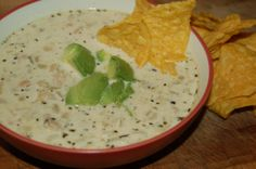 Creamy White Chicken Chili (OMGOSH...THIS WAS THE BEST CHICKEN CHILI EVER!!! Made exactly as shown(used 1/2 amount of green chilies) the only thing I wished I'd done different is double it! The three of us ate it all up with cornbread. The best!!!)