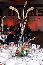 Hockey Stick Centerpieces. I would do this, maybe with mini sticks tho. my family is dangerous.