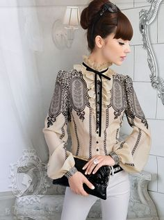 Amazing Victorian inspired blouse.  I think I shall start dressing this way full time..