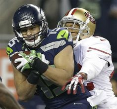 Seattle Seahawks' Jermaine Kearse catches a touch-down pass in front of San Francisco 49ers' Carlos Rogers during the second half of the NFL...