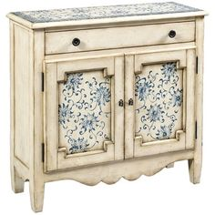 Cabinet with Pretty Design On Top & On Both Doors.