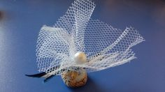 Navy blue and white gifts in a wedding basket.
