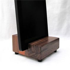 This stand has a 1/2 slot to fit devices and cases less than 1/2 thick. Pictured with iphone 6 and Kindle Fire HD7.   (Unit Z12): Beautiful mix of hardwoods.   Base - 3 3/4 wide  Slot - 1/2 (0.50, 13mm) wide  Center hole - 3/8 (13mm) diameter, fits lightning cable, micro usb  Rubber bumpers - 7mm rise   This stand is a unique mix of hardwoods. It is made of Brazilian cherry and walnut. The wood for my stands is carefully selected to create beautiful individual designs...