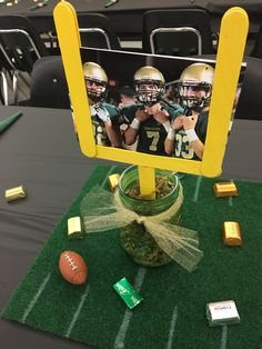 Football banquet centerpiece - -You can find Banquet and more on our website. Football Crafts, Football Themes, Senior Football Gifts, Kids Football Parties, Football Locker Decorations, Football Player Gifts, Football Decor, Football Centerpieces, Banquet Decorations